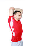 Pensive sports man stretching the arms. Over a white background Royalty Free Stock Photo