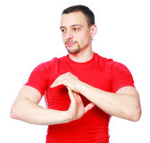 Pensive sportsman stretching arms Royalty Free Stock Images