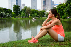 Pensive sporty woman taking a workout rest Royalty Free Stock Photos