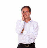 Pensive stressed hispanic man looking up Royalty Free Stock Photography