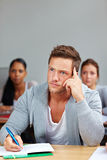 Pensive student in university class Royalty Free Stock Photo