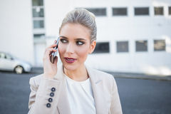 Pensive stylish businesswoman having a phone call Royalty Free Stock Photo