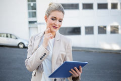 Pensive stylish businesswoman using digital tablet Stock Photos