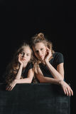 Pensive stylish daughter and mother looking at camera Royalty Free Stock Photos