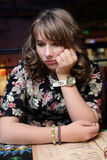 Pensive teen in cafe Royalty Free Stock Photos