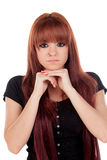 Pensive teenage girl dressed in black with a piercing Stock Photos