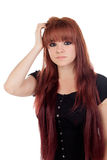 Pensive teenage girl dressed in black with a piercing Royalty Free Stock Images