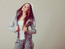 Pensive teenage girl in hooded sweatshirt. Fashion Stock Image