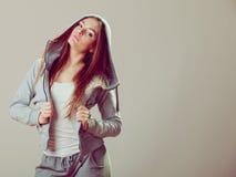 Pensive teenage girl in hooded sweatshirt. Fashion Royalty Free Stock Photos