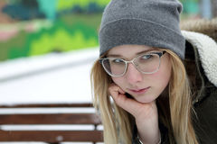 Pensive teenager on bench Royalty Free Stock Photography