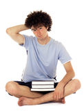 Pensive teenager with books. Pensive teenager with books sitting on the floor,looking up and has downcast appearance.  on white Stock Images