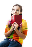 Pensive teenager girl with book Royalty Free Stock Photos