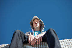 Pensive Teenager outdoor. Pensive Teenager sit on the Roof Of the Building Royalty Free Stock Photography