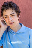 Pensive teenager on phone Royalty Free Stock Images