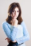 Pensive teenager on white. Portrait of a pensive woman on white background Stock Images