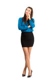 Pensive thinking business woman standing with crossed legs Stock Photography