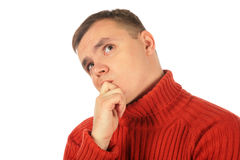 Pensive thinking young man in red sweater Stock Images
