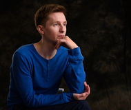 Pensive thinking young man Stock Photos