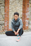 Pensive tired fitness woman Stock Photography