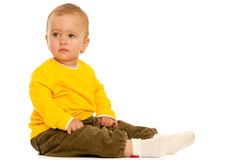 Pensive toddler in yellow Stock Photos