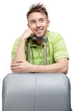 Pensive tourist leaning on travel trunk Royalty Free Stock Photo