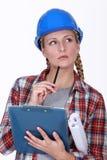 A pensive tradeswoman Stock Photography