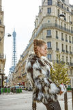 Pensive trendy fashion-monger with Christmas tree in Paris Royalty Free Stock Photos