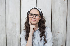 Pensive trendy woman with stylish glasses posing Royalty Free Stock Photo