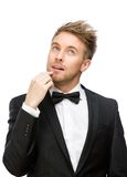 Pensive white collar touching face Stock Photo