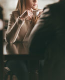 Pensive woman at the bar having a coffee Royalty Free Stock Photos