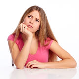 Pensive woman behind a table Royalty Free Stock Photos