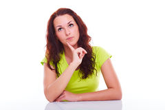Pensive woman behind a table Royalty Free Stock Image