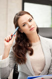 Pensive woman with big notepad Stock Images