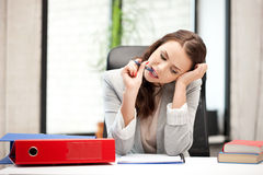 Pensive woman with big notepad Royalty Free Stock Image