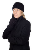 Pensive woman with a black coat Stock Image