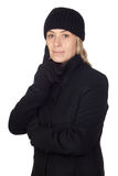 Pensive woman with a black coat stock photography