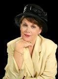 Pensive Woman In Black Hat Stock Photo