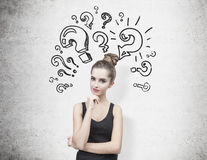 Pensive woman in a black tank top and questions Stock Image