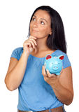 Pensive woman with a blue money-box Royalty Free Stock Image
