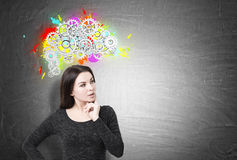 Pensive woman, brain and cogs Royalty Free Stock Photos