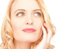 Pensive woman. Bright closeup picture of beautiful pensive woman Royalty Free Stock Photography