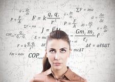 Pensive woman in brown, formulas Royalty Free Stock Images