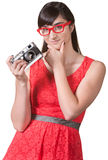 Pensive Woman with Camera Royalty Free Stock Photos