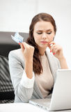 Pensive woman with computer and euro cash money Royalty Free Stock Images