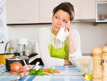 Pensive woman cooks rice with vegetables Stock Photo