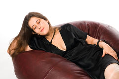 Pensive woman on couch Royalty Free Stock Images