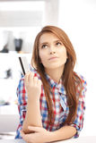 Pensive woman with credit card Royalty Free Stock Photography
