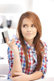 Pensive woman with credit card Royalty Free Stock Images