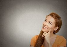 Pensive woman daydreaming royalty free stock image