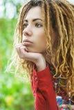 Pensive woman with dreadlocks closeup Stock Photos